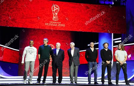 Draw assistants (L-R), Cafu, Laurent Blanc, Nikita Simonyan, Gordon Banks, Fabio Cannavaro, Diego Forlan, and Carles Puyol pose for photographers on stage on the eve of the FIFA World Cup 2018 Final Draw in the State Kremlin Palace in Moscow, Russia, 30 November 2017. The Final Draw for the FIFA World Cup 2018 in Russia will take place in Moscow on 01 December 2017.