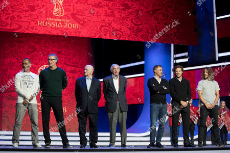 Carles Puyol, Cafu, Laurent Blanc, Nikita Simonjan, Gordon Banks, Fabio Cannavaro, Diego Forlan. From left: draw assistants and former soccer players Cafu, Laurent Blanc, Nikita Simonjan, Gordon Banks, Fabio Cannavaro, Diego Forlan and Carles Puyol stand on the stage during a photo call in the State Kremlin Palace in Moscow, Russia, . The Final Draw for the 2018 soccer World Cup in Russia will take place on Dec. 1 in the State Kremlin Palace in Moscow