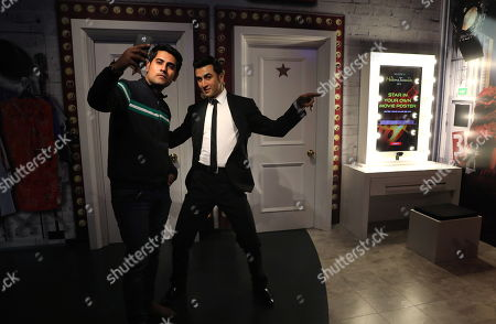 An Indian visitor takes a selfie with a wax figure of Indian Bollywood actor Ranbir Kapoor at the Madame Tussauds wax museum in New Delhi, India, 30 November 2017. The wax museum will be open for the visitors from 01 December on. Madame Tussauds New Delhi features 50 wax figures of personalities from the fields of sports, music, film, history and politics.