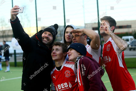 Stock Picture of Danny Mills takes a selfie with the young Fleetwood players