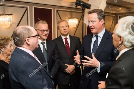 Prime Minister David Cameron with Lady Gilda Levy, Simon Morris Chief Executive of Jewish Care, Steven Lewis Chairman of Jewish Care, Stephen Zimmerman and Lord Lord Levy.