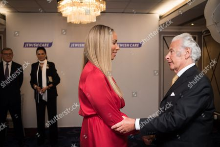 Leona Lewis with Lord Lord Levy, Gerald Ronson CBE and Dame Gail Ronson look on.