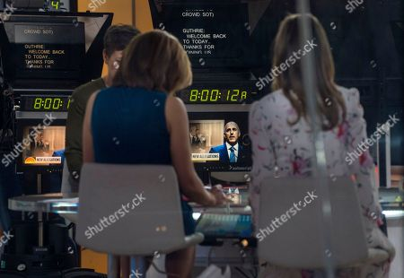 """Co-anchors Hoda Kotb, center left, and Savannah Guthrie, right, sit on the set during a news segment of """"Today"""" show, in New York, in the wake of the firing of longtime """"Today"""" show anchor and host Matt Lauer, for """"inappropriate sexual behavior."""" Lauer said Thursday that repairing the damage that he has caused is now his full-time job"""