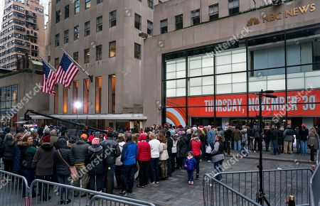 """People stand outside the set of """"Today"""" show during the broadcast, in New York, in the wake of the firing of longtime """"Today"""" show anchor and host Matt Lauer, for """"inappropriate sexual behavior."""" Lauer said Thursday that repairing the damage that he has caused is now his full-time job"""