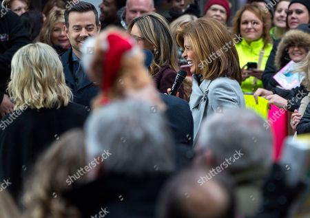 """Stock Picture of Anchor and co-host Hoda Kotb, center right, joins visitors during the broadcast outside the set of """"Today"""" show, in New York, in the wake of the firing of longtime """"Today"""" show anchor and host Matt Lauer, for """"inappropriate sexual behavior."""" Lauer said Thursday that repairing the damage that he has caused is now his full-time job"""