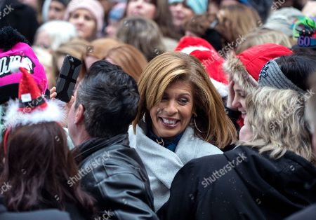 """Anchor and co-host Hoda Kotb, center, joins visitors during the broadcast outside the set of """"Today"""" show, in New York, in the wake of the firing of longtime """"Today"""" show anchor and host Matt Lauer, for """"inappropriate sexual behavior."""" Lauer said Thursday that repairing the damage that he has caused is now his full-time job"""