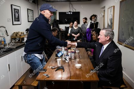 Philadelphia Mayor Jim Kenney, right, and Todd Carmichael, Ceo and Co-founder of La Colombe, shake hands in Philadelphia