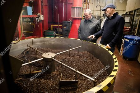 Stock Picture of Philadelphia Mayor Jim Kenney, center, meets with Todd Carmichael, Ceo and Co-founder of La Colombe, during a tour of the coffee roasting facility in Philadelphia