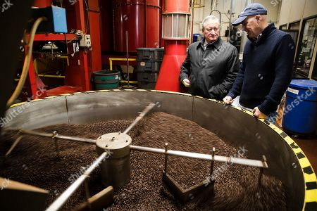 Philadelphia Mayor Jim Kenney, center, meets with Todd Carmichael, Ceo and Co-founder of La Colombe, during a tour of the coffee roasting facility in Philadelphia