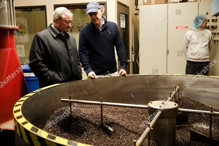 Stock Image of Philadelphia Mayor Jim Kenney, left, meets with Todd Carmichael, Ceo and Co-founder of La Colombe, during a tour of the coffee roasting facility in Philadelphia