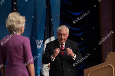 Stock Image of Secretary of State Rex Tillerson walks to his seat for a conversation with Wilson Center President and CEO Jane Harman at the Wilson Center in Washington