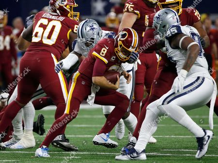 Kirk Cousins, DeMarcus Lawrence. Washington Redskins quarterback Kirk Cousins (8) is sacked by Dallas Cowboys defensive end DeMarcus Lawrence, rear, causing Cousins to fumble the ball in the first half of an NFL football game, in Arlington, Texas. The Cowboys recovered the ball