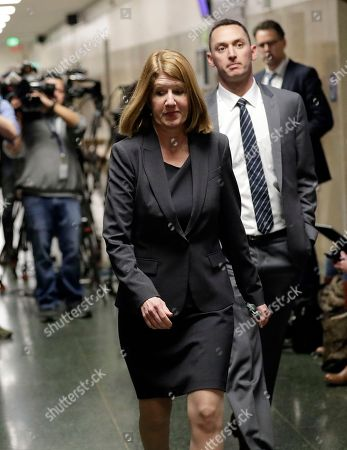 Stock Photo of San Francisco Deputy District Attorney Diana Garcia walks to the courtroom after a verdict was reached in the trial of Jose Ines Garcia Zarate, in San Francisco. Garcia Zarate was found not guilty in the killing of Kate Steinle on a San Francisco pier that touched off a national immigration debate two years ago, rejecting possible charges ranging from involuntary manslaughter to first-degree murder