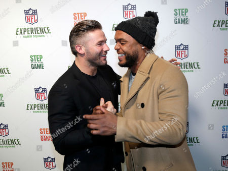 """Julian Edelman, Shane Vereen. New England Patriots Julian Edelman, left, and New York Giants Shane Vereen greet one another at the opening of """"NFL Experience"""" in Times Square, New York, . The new attraction has four floors of interactive exhibits and games about football and the NFL"""