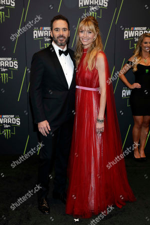 Jimmie Johnson, left, and Chandra Johnson arrive at the NASCAR Cup Series auto racing awards, in Las Vegas