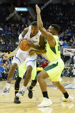 Kansas City, MO. U.S. - Creighton Bluejays guard Marcus Foster #0 drives through Baylor defenders Manu Lecomte #20 and King McClure #22 in 1st half action during the Hall of Fame Classic men's basketball game between #22 Baylor Bears and Creighton Bluejays at the Sprint Center in Kansas City, MO..Baylor won 65-59