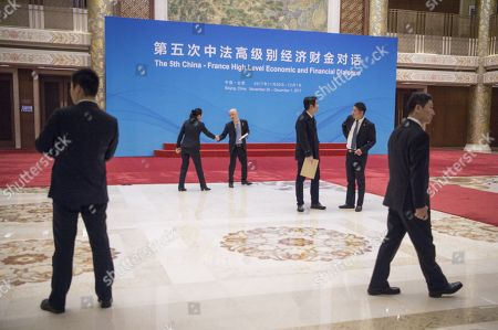 Security guards and delegates wait for the arrival of Chinese Vice Premier Ma Kai and French Economy Minister Bruno Le Maire during the fifth China-France High Level Economic and Financial Dialogue in Beijing at Diaoyutai State Guesthouse in Beijing, China, 01 December 2017.
