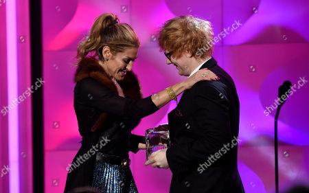 Ed Sheeran, Julie Greenwald. Ed Sheeran, right, presents the award for executive of the year to Julie Greenwald