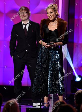 Julie Greenwald, Ed Sheeran. Julie Greenwald accepts the executive of the year award. Looking on at left is presenter Ed Sheeran