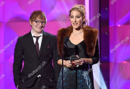 Julie Greenwald, Ed Sheeran. Ulie Greenwald accepts the executive of the year award at the Billboard Women in Music event at the Ray Dolby Ballroom, in Los Angeles. Looking on at left is presenter Ed Sheeran