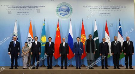 Stock Picture of (L-R) SCO Secretary General Rashid Alimov, Indian Foreign Minister Sushma Swaraj, Kazakstan's Minister Bakhytzhan Sagintayev, Chinese Premier Li Keqiang, Russian Prime Minister Dmitry Medvedev, Kyrgyzstan's Prime Minister Sapar Isakov, Pakistan's Prime Minister Shahid Khaqan Abbasi, Tajikistan's Prime Minister Kokhir Rasulzoda ,  Uzbekistan's Prime Minister Abdulla Aripov and Director of the Executive Committee of the SCO Regional Anti-Terrorist Structure Yevgeny Sysoyev  attend a photo session for heads of delegations of the Shanghai Cooperation Organization (SCO) member states in the Black sea resort of Sochi, Russia, 01 December 2017. The Shanghai Cooperation Organization (SCO) Heads of Government summit takes place in Sochi from 30 November to 01 December 2017.