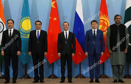 (L-R) Kazakstan's Minister Bakhytzhan Sagintayev, Chinese Premier Li Keqiang, Russian Prime Minister Dmitry Medvedev, Kyrgyzstan's Prime Minister Sapar Isakov and Pakistan's Prime Minister Shahid Khaqan Abbasi attend a photo session for heads of delegations of the Shanghai Cooperation Organization (SCO) member states in the Black sea resort of Sochi, Russia, 01 December 2017. The Shanghai Cooperation Organization (SCO) Heads of Government summit takes place in Sochi from 30 November to 01 December 2017.