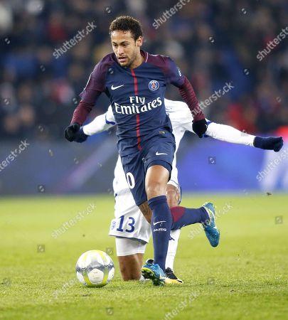 Neymar dribbles past Troyes' Saif-Eddine Khaoui