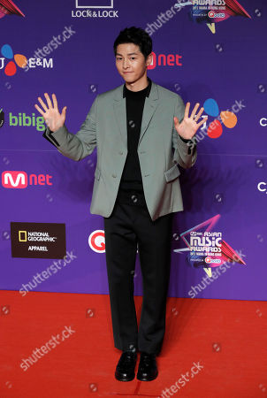 South Korean actor Song Joong-ki poses for photos on the red carpet of the Mnet Asian Music Awards (MAMA) in Hong Kong