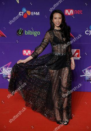 Hong Kong singer-actress Karen Mok poses for photos on the red carpet of the Mnet Asian Music Awards (MAMA) in Hong Kong