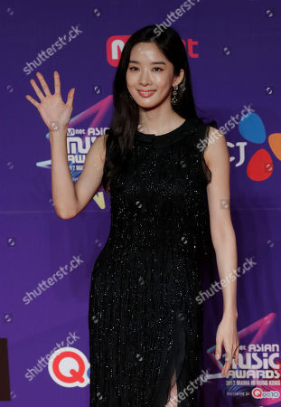 South Korean actress Lee Chung-ah poses for photos on the red carpet of the Mnet Asian Music Awards (MAMA) in Hong Kong