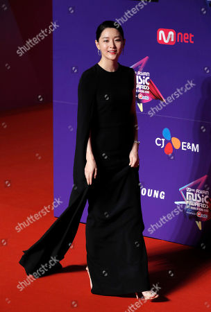 South Korean actress Lee Young-ae poses for photos on the red carpet of the Mnet Asian Music Awards (MAMA) in Hong Kong