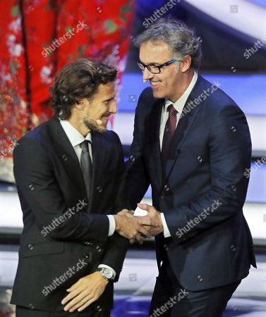 Diego Forlan and Laurent Blanc