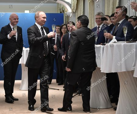 FIFA president Gianni Infantino (L), Russian President Vladimir Putin (2-L), former Argentine international Diego Maradona (C) and  former Italian international Fabio Cannavaro (R) toast  before the start of the Final Draw of the FIFA World Cup 2018 at the State Kremlin Palace in Moscow, Russia, 01 December 2017. The FIFA World Cup 2018 will take place from 14 June until 15 July 2018 in Russia.