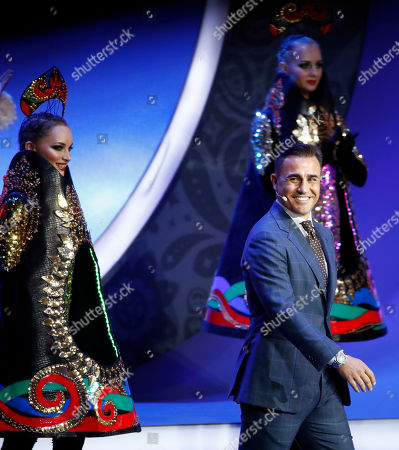Former Italian soccer international Fabio Cannavaro smiles as he walks on stage to assist with the 2018 soccer World Cup draw in the Kremlin in Moscow