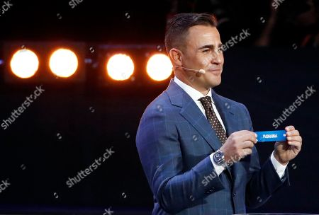 Former Italian soccer international Fabio Cannavaro holds up the team name of Panama during the 2018 soccer World Cup draw in the Kremlin in Moscow