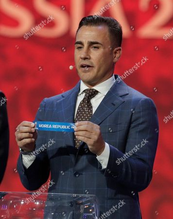 Former Italian soccer international Fabio Cannavaro holds up the name team of South Korea during the 2018 soccer World Cup draw in the Kremlin in Moscow