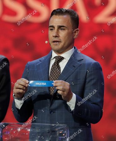 Former Italian soccer international Fabio Cannavaro holds up the name team of Nigeria during the 2018 soccer World Cup draw in the Kremlin in Moscow