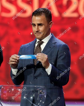 Former Italian soccer international Fabio Cannavaro holds up the name team of Panama during the 2018 soccer World Cup draw in the Kremlin in Moscow