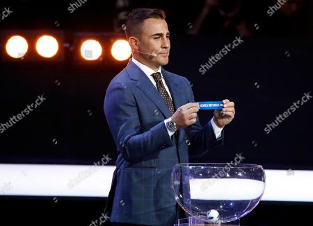 Former Italian soccer international Fabio Cannavaro holds up the team name of South Korea during the 2018 soccer World Cup draw in the Kremlin in Moscow