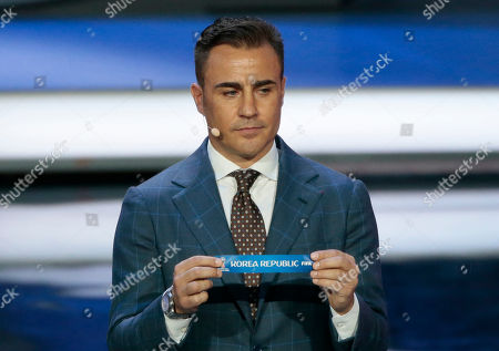 Former Italian soccer international Fabio Cannavaro holds up the team name of South Korea at the 2018 soccer World Cup draw in the Kremlin in Moscow