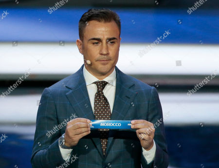 Former Italian soccer international Fabio Cannavaro holds up the team name of Morocco the 2018 soccer World Cup draw in the Kremlin in Moscow
