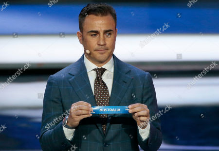 Former Italian soccer international Fabio Cannavaro holds up the team name of Australia the 2018 soccer World Cup draw in the Kremlin in Moscow