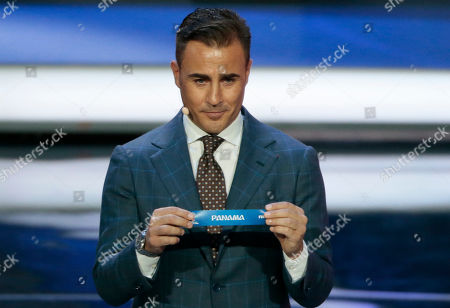 Former Italian soccer international Fabio Cannavaro holds up the team name of Panama at the 2018 soccer World Cup draw in the Kremlin in Moscow