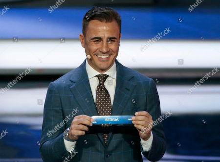 Former Italian soccer international Fabio Cannavaro holds up the team name of Serbia at the 2018 soccer World Cup draw in the Kremlin in Moscow