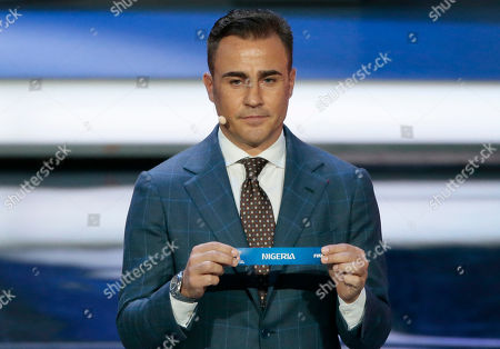 Former Italian soccer international Fabio Cannavaro holds up the team name of Nigeria at the 2018 soccer World Cup draw in the Kremlin in Moscow