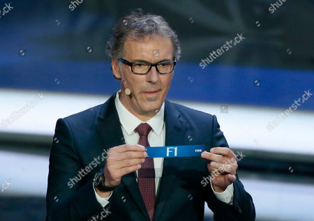 Former French soccer international Laurent Blanc holds a lot at the 2018 soccer World Cup draw in the Kremlin in Moscow