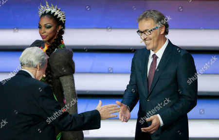 Former English soccer international Gordon Banks, left, shakes hand with Former French soccer international Laurent Blanc at the 2018 soccer World Cup draw in the Kremlin in Moscow