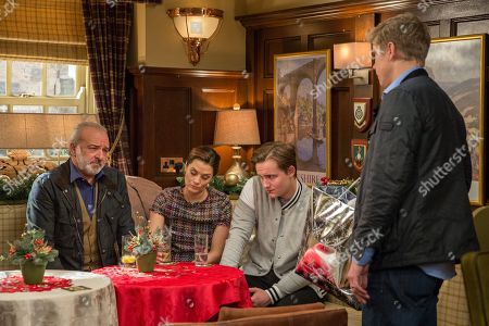 Stock Picture of Ep 8022 Friday 22nd December 2017  Robert Sugden, as played by Ryan Hawley, tries to give Seb's gifts to Lawrence White, as played by John Bowe, but he gets a hostile reaction from the Whites.