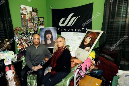 David Gregory, Kimberly Gregory. David Gregory, at left, and his wife Kimberly pose for a photo inside their daughter Michela's bedroom with some items from her memorial in South San Francisco, Calif. Michela died along with her boyfriend Alex Vega a year ago during a fire at the Ghost Ship warehouse in Oakland, Calif. The one-year anniversary of the deadliest building fire in the U.S. in more than a decade is bringing back painful memories for victims' families. It's also refocusing attention on Oakland, California, where the blaze occurred. Some critics say the beleaguered city hasn't moved quickly enough to prevent a similar tragedy