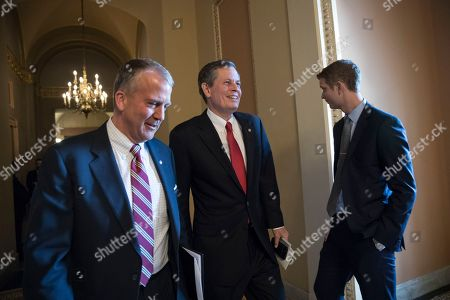 Dan Sullivan, Steve Daines. Sen. Dan Sullivan, R-Alaska, left, walks with Sen. Steve Daines, R-Mont., as they head to the Senate chamber after a closed-door meeting with Republican lawmakers to advance the GOP overhaul of the tax code, on Capitol Hill in Washington